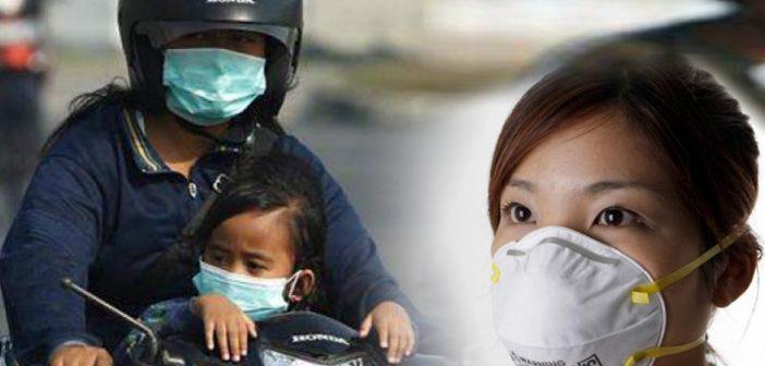 penggunaan masker pada asap kebakaran hutan